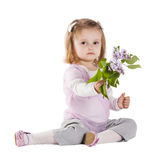 Little girl giving a branch of lilac Stock Photos