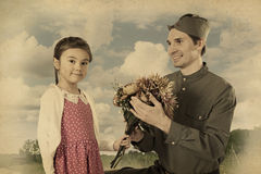 Little girl giving bunch of flowers to Soviet soldier Stock Images