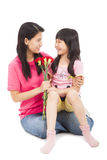 Little girl giving carnation flowers. On mother's day Stock Photos