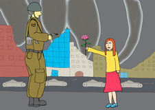 Little girl giving a flower to a soldier Stock Photo