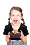 Little girl giving gift Stock Images