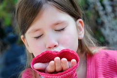Little girl giving a hand kiss Royalty Free Stock Photos
