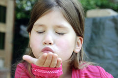 Little girl giving a hand kiss Royalty Free Stock Photography