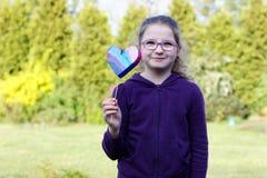 Girl. Little girl giving hand made heart Royalty Free Stock Image