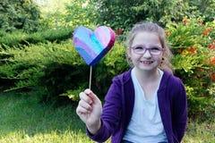 Girl. Little girl giving hand made heart Stock Image