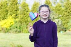Girl. Little girl giving hand made heart Stock Photos
