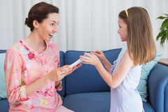 Little girl giving her mother a gift Royalty Free Stock Photography