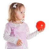 Little girl giving red ball Stock Photos