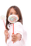 Little girl giving sweet marshmallow candy to you Stock Photos