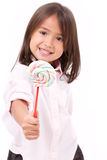 Little girl giving sweet marshmallow candy to you Royalty Free Stock Image