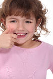 Little girl giving thumbs-up Stock Photography