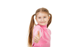 Little girl giving thumbs up sign isolated on white background Royalty Free Stock Image