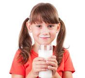 Little girl with a glass of buttermilk Royalty Free Stock Photo