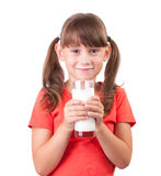 Little girl with a glass of buttermilk stock photography