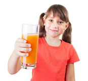Little girl with a glass of fresh juice Stock Photo