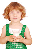 Little girl with glass of milk Royalty Free Stock Image