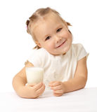 Little girl with a glass of milk Royalty Free Stock Images