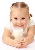 Little girl with a glass of milk Stock Photos