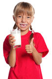 Little girl with glass of milk Royalty Free Stock Photo