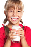 Little girl with glass of milk Royalty Free Stock Photography
