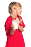 Little girl with glass of milk Stock Images