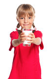 Little girl with glass of milk Stock Photos
