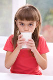 Little girl with a glass of milk Royalty Free Stock Photo