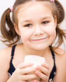 Little girl with a glass of milk Royalty Free Stock Photography