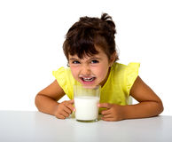 Little girl with glass of milk Stock Image