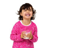 Little girl with glass of milk Stock Photo