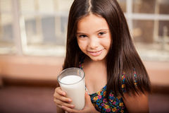 Little girl with a glass of milk Royalty Free Stock Photos