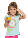 Little girl with a glass of orange juice Stock Image