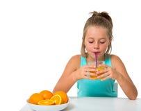 Little girl with glass of orange juice Stock Photo