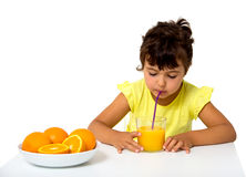 Little girl with glass of orange juice Stock Photography