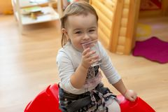Little girl with a glass of water royalty free stock photos