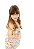 Little girl with glass of water. Isolated on white background stock image