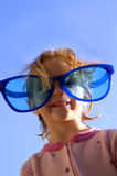 Little Girl Glasses. Little girl wearing goofy sunglasses Stock Photo