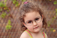 Little girl and glasses Royalty Free Stock Photo
