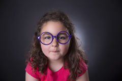 Little girl and glasses Stock Image