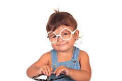 Little girl and glasses Royalty Free Stock Images