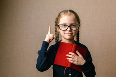 Little girl in glasses with book stock photo