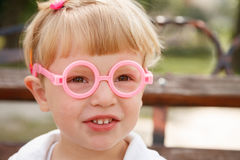 Little girl in glasses Royalty Free Stock Image