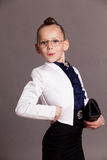 Little girl in glasses dressed as business Lady royalty free stock photo