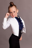 Little girl in glasses dressed as business Lady stock photography