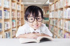 Little girl with glasses in the library Stock Photos