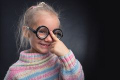 Little girl in glasses makes faces Royalty Free Stock Photography