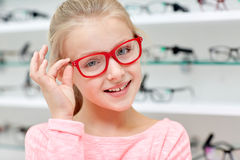 Little girl in glasses at optics store Stock Photography
