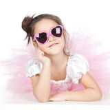 Little girl with glasses in a pink dress Stock Photography