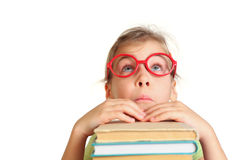 Little girl in glasses pose face, look up. Put hands on books Stock Photography