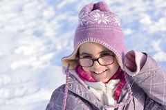 Little girl with glasses posing in the snow Royalty Free Stock Photos